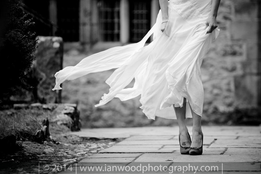 A black and white, artistic image of a brides dress taken by Ian Wood who is a Wedding photographer in Cumbria. I understand the dress is a bespoke item by Ele Horsley.