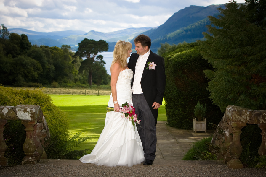 A Bride and Groom at a romantic Lake District wedding venue at Armathwaite Hall a wedding venue in the Lake District.