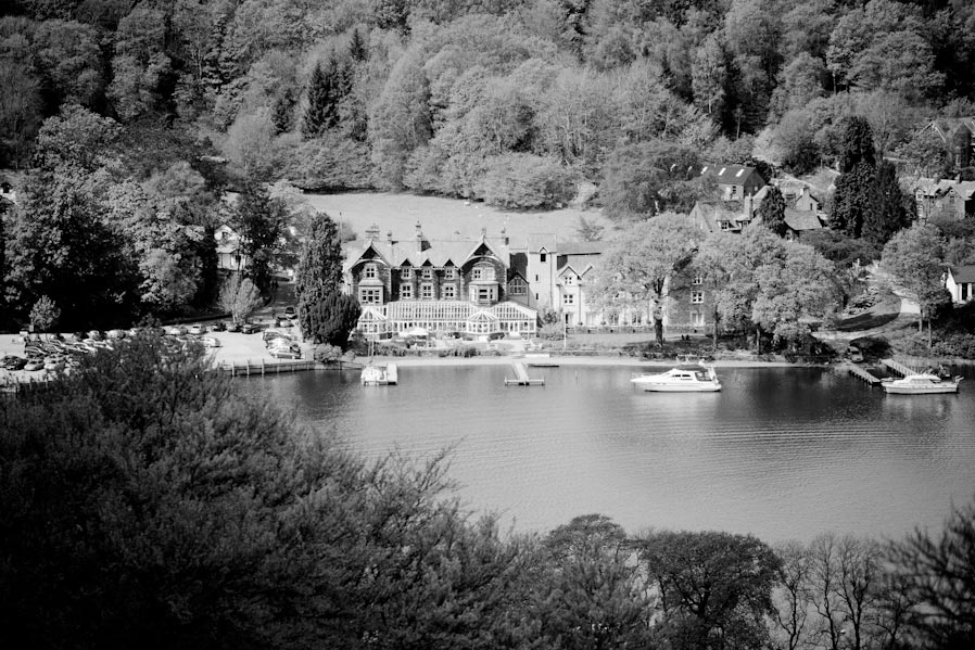 A black and white image of the Lakeside Hotel at Newby Bridge taken from Gummers How.