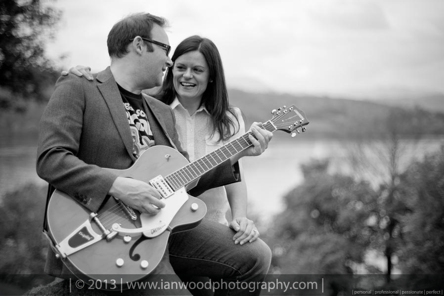 A Bride to be being serenaded by her partner overlooking Lake Windermere.